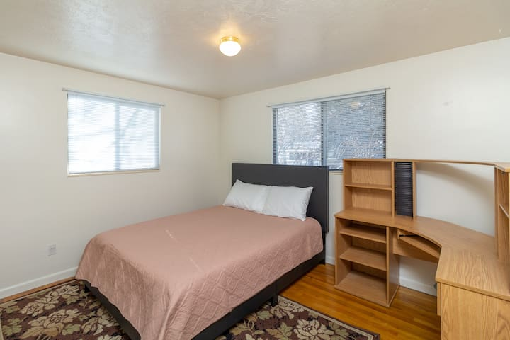 Bedroom #1, with a Queen bed and full size desk so you can get some work done while you are away.
