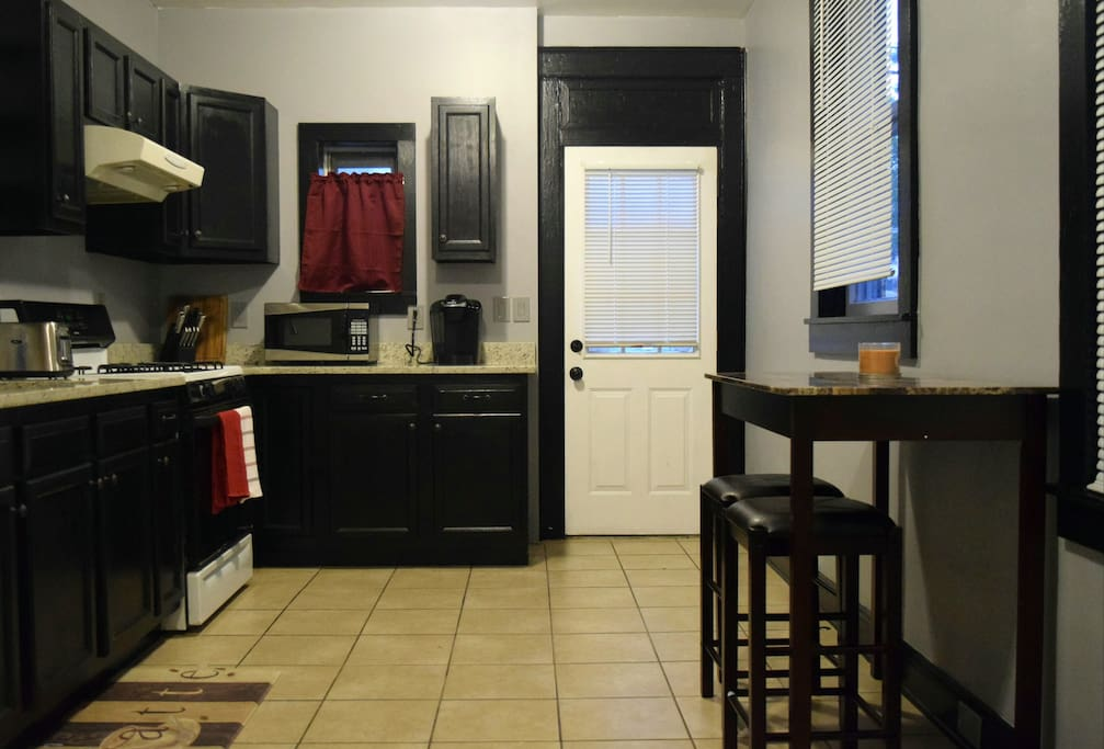 Kitchen, fully equipped.  Stove, refrigerator, microwave, keurig machine, toaster, pots, pans.