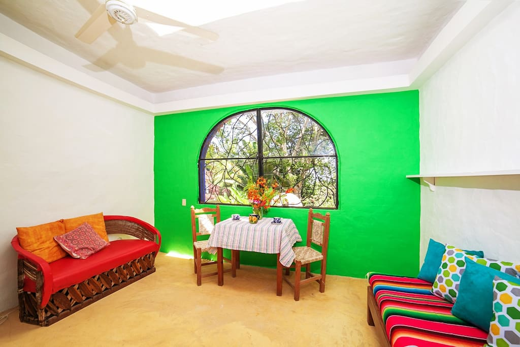 Green Studio Bedroom large and airy with 2 ceiling fans, a queen size bed and a day bed.
