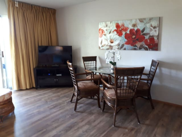 Bright spacious living/dining area with patio doors to lanai.