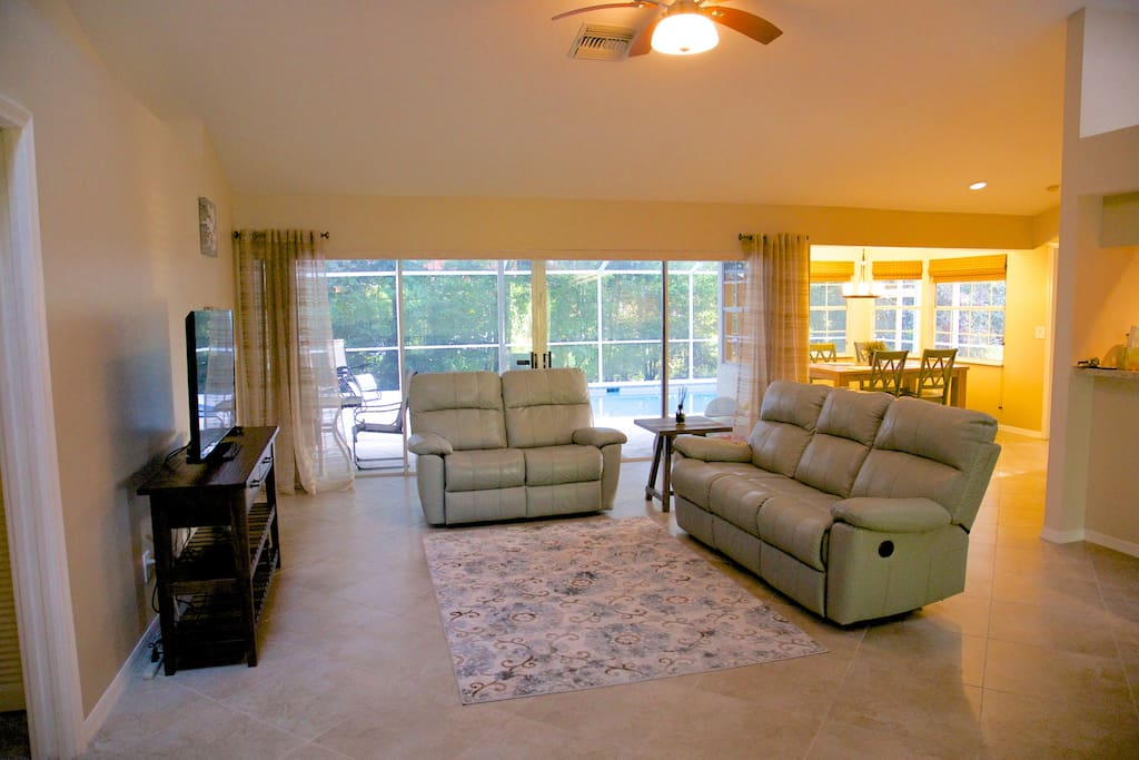 Large open living room with reclining sofa and loveseat