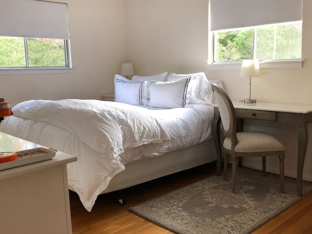 Cozy room with writing desk, mini fridge and k-cup coffee maker.