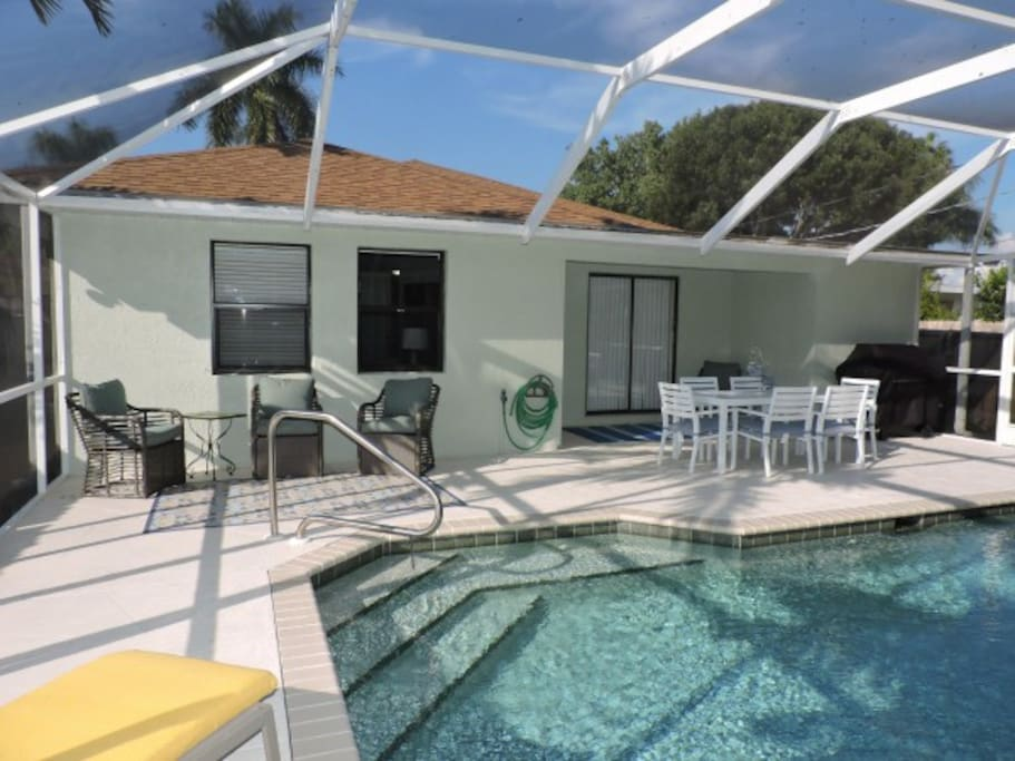 Large, screened lanai area completely fenced for privacy.  5 burner barbecue grill provided.