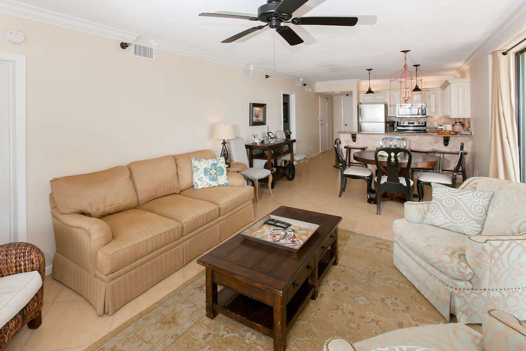 Fully furnished living room with ceiling fan