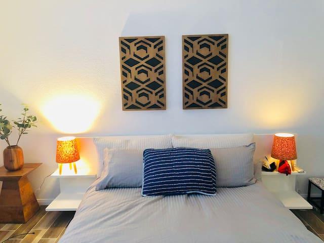 second guest bedroom with queen bed