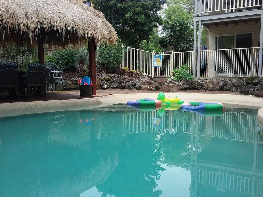 Easy access to the pool. Pool toys for fun.   Fully fenced for safety.  8 seating dining under the cool Bali hut.
