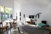 living space with dining table & platinum foxtel