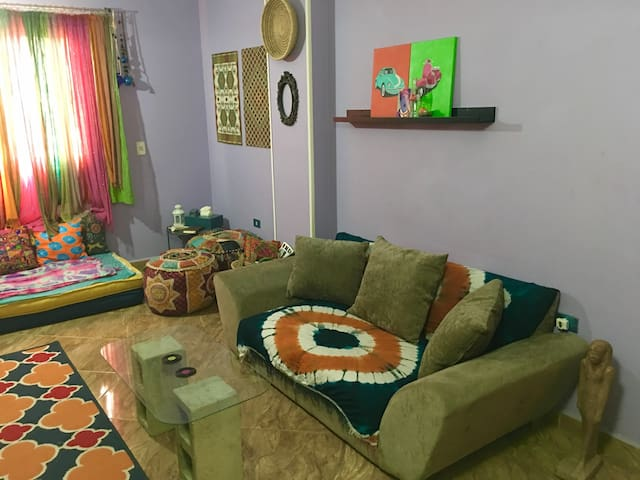 Clean private room in a colorful flat near airport