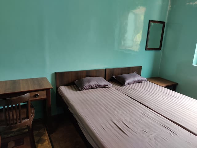 Private twin room with two beds