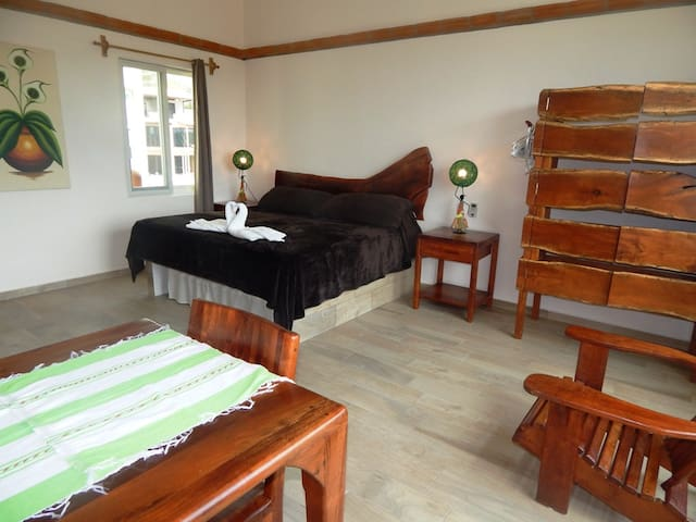 Very comfortable king size bed and special mesquite furniture Studio Iguana