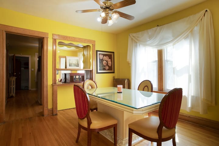 Formal dinning room for eating or game night.  Original hardwood flooring thru out apartment.