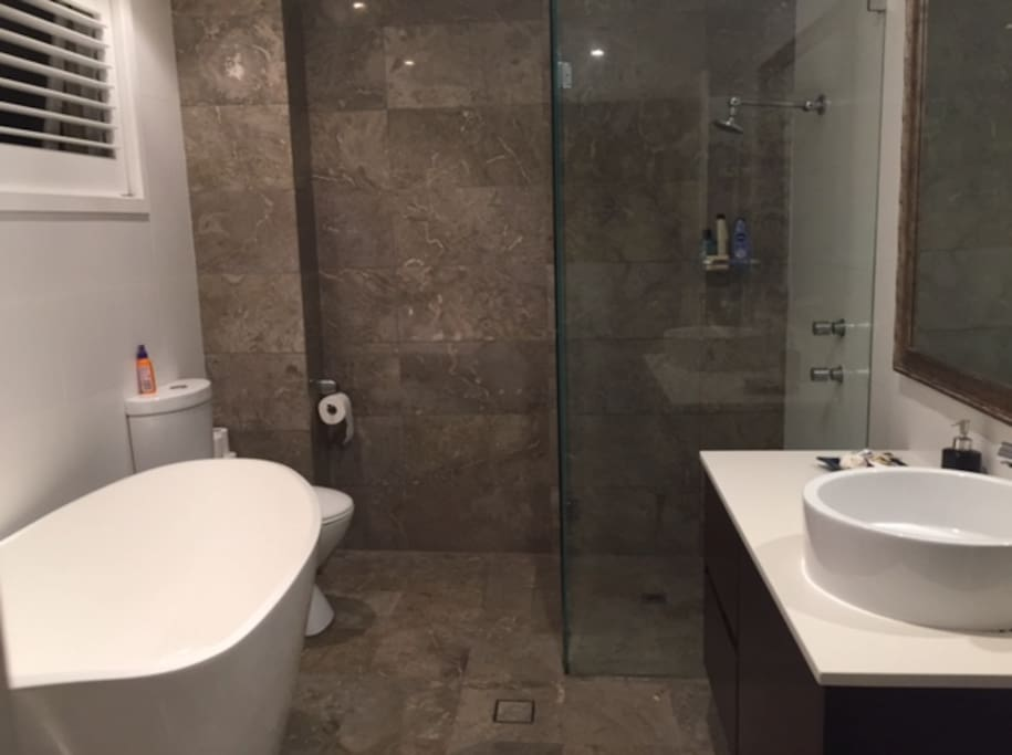 Guest bathroom with bath, shower and toilet