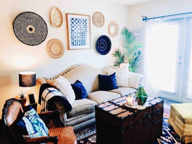 the living space provides entertainment & comfort with both unique & cozy design elements.