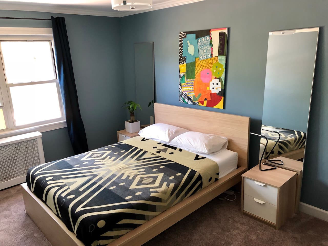 Have a restful stay in this spacious room with a queens size bed!