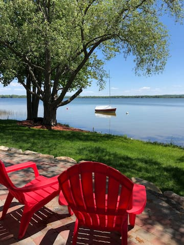 The guest cottage patio is literally steps from the water!