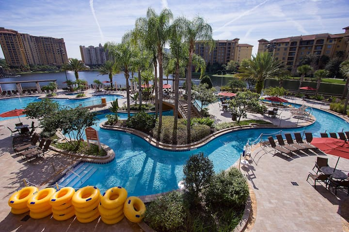 On Disney Property 2 Bedroom Deluxe with Balcony close to Premium outlets with Free Parking! Access to 5 pools, lazy river, BBQ area, mini golf and more.