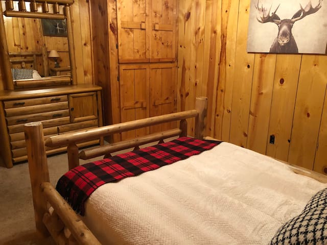 Basement level guest room with queen bed