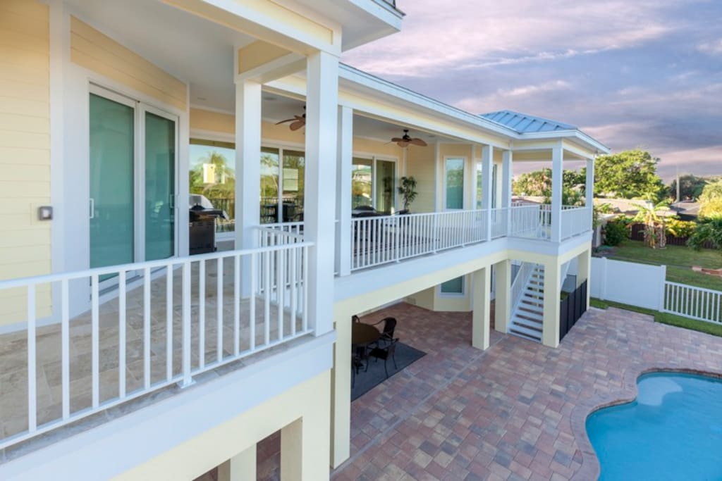 Enjoy serene canal and pool views from your covered porch