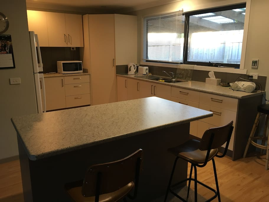 large kitchen with all cooking needs plus pantry with usual foodstuffs which you are welcome to use.