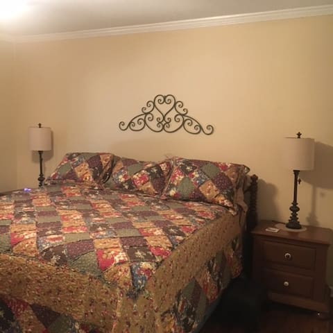 Relax in the Master bedroom on the luxurious, tall king bed with nightstands, lamps and a charging station on either side.    Luggage racks in can be found in the spacious closet.