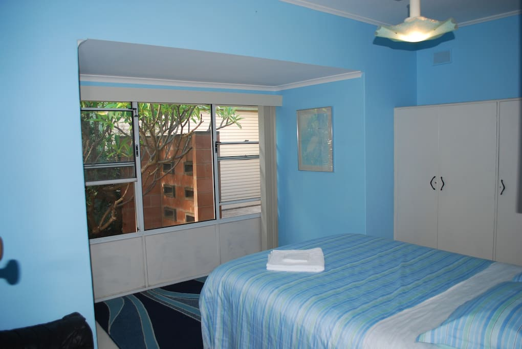 The Blue Room has a large bay window with vertical blinds and a couch for your stuff. Or to sit on