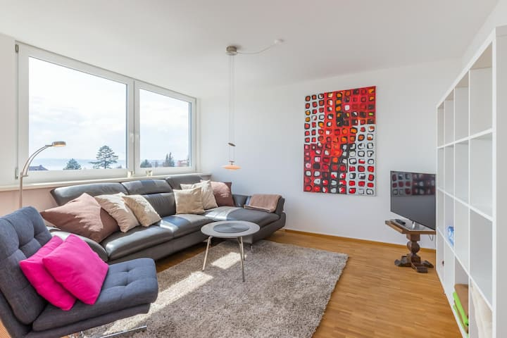 Modern Holiday Apartment with Lake and Alpine View, Wi-Fi and Balcony; Parking Available