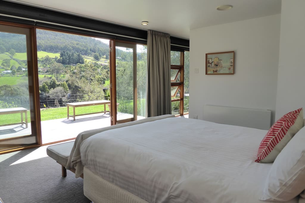 This is the main bedroom, which has expansive rural views across the river.
