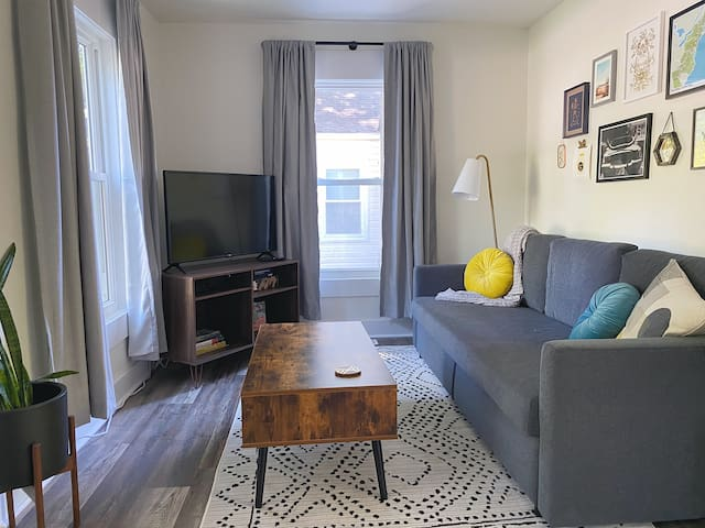 Living room with sofa bed and smart tv