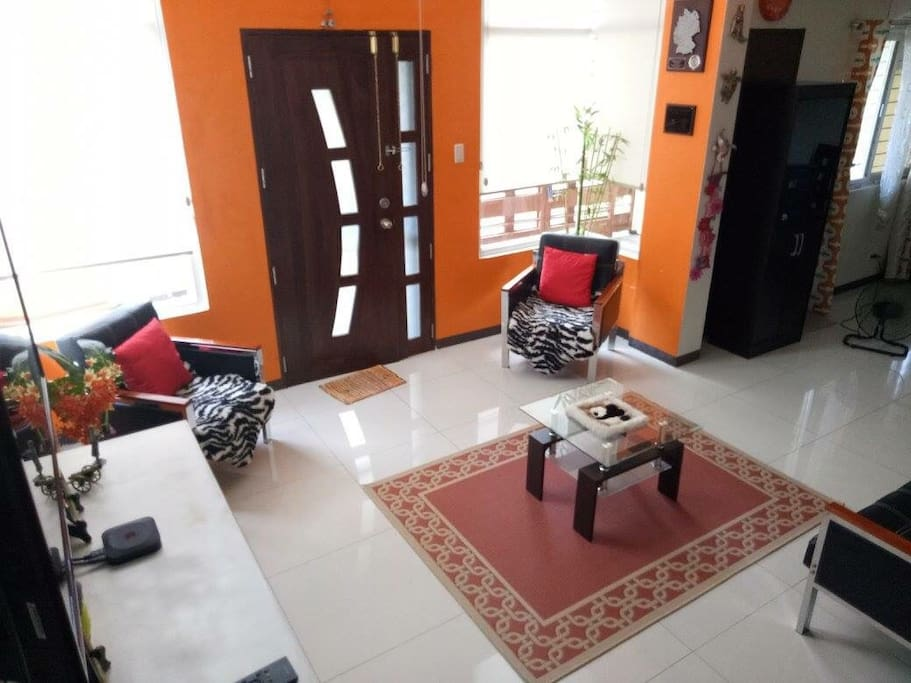 Living room with television, DVD player, Apple TV, playstation 3 with games.