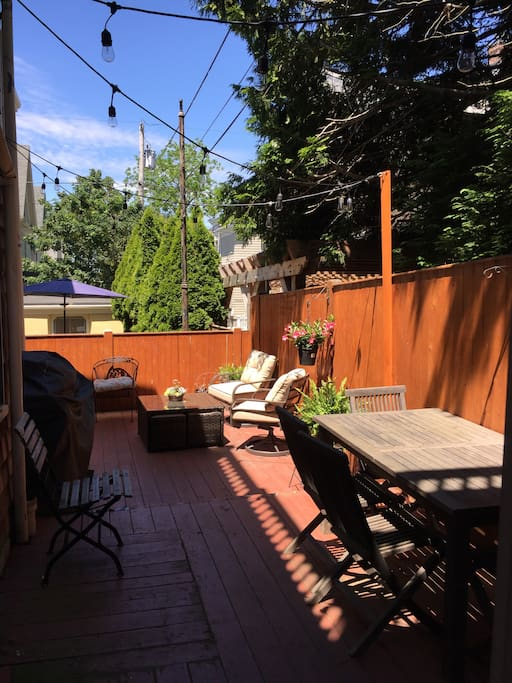 Private back deck w/SS grill, dining and sitting areas with fantastic outdoor lighting!