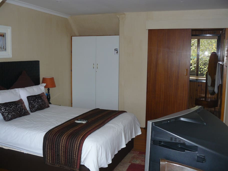 Lagoon Lodge - room 1 with it's double bed & en-suite bathroom with shower