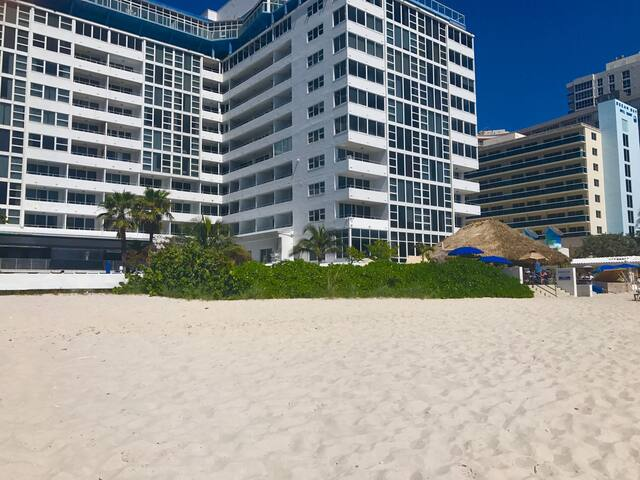 Beautiful white sandy private beach in front of your hotel. Tiki bar/restaurant to the right.