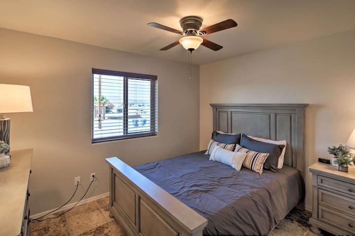 A queen bed is provided in the second bedroom