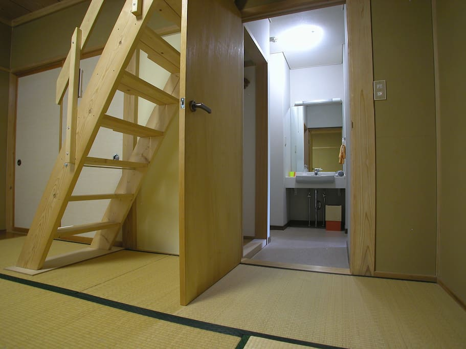 Guest rooms entrance area with toilet, wash basin & open storage.