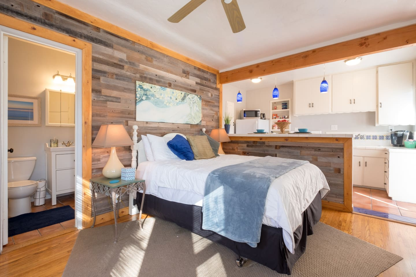 Our spacious studio unit has reclaimed wood and a beautiful open floor plan