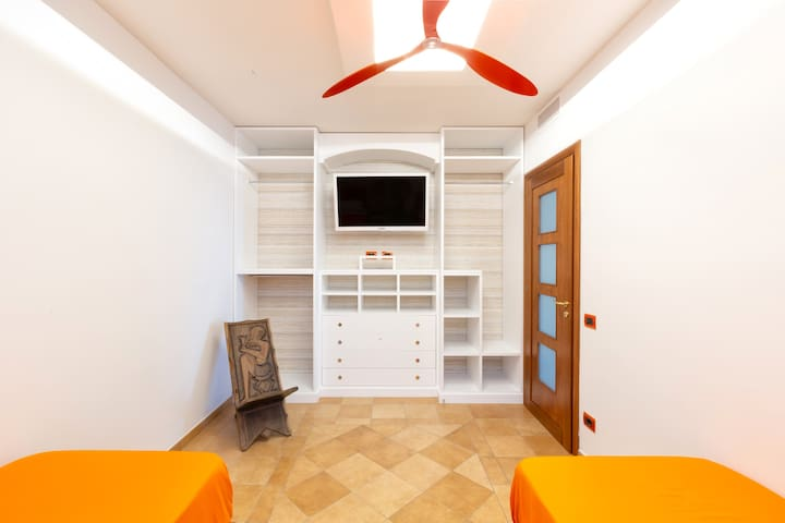 Bedroom 3 - Two Single Beds with Fresh Linens, Cooling Fan, Free Wi-Fi 24hrs, Wardrobe and Storage Space, Flat Screen TV