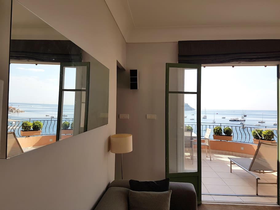 Living Area leading on to Terrace with Feature Mirror reflecting the beautiful views