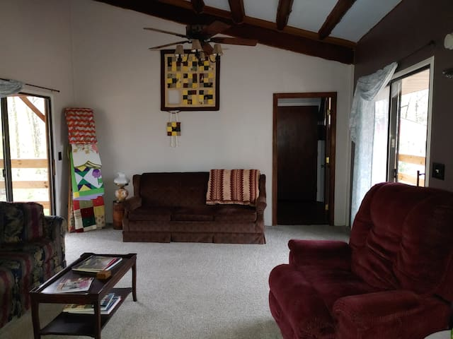 Gathering room. The doorway on the right side leads to bedroom 2.