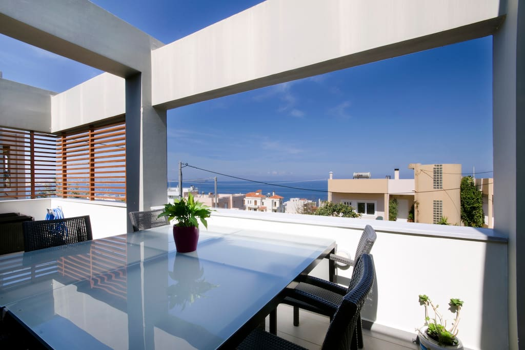 Large patio with dinning area to enjoy the endless sea view and the view of Chania.