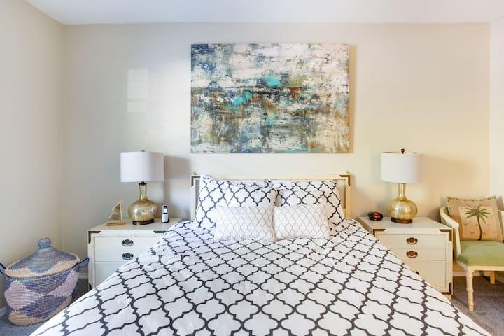 master bedroom features a queen bed...