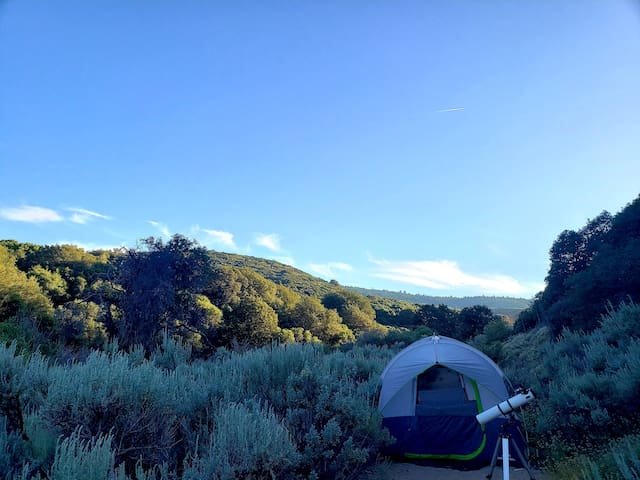 Glamp site in private valley surrounded by sage