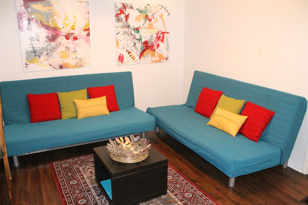 Spacious Living Room with Two Futon Sofa Beds