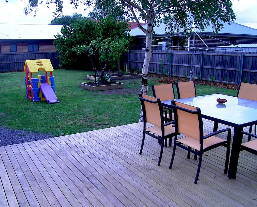 Large fenced outdoor play area and garden