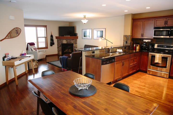 Living/Kitchen open plan space. The Dining area has seating for 6, and the kitchen counter seats 3.