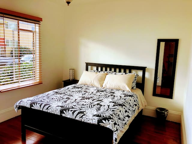 Master bedroom, queen-sized bed, lots of natural light. Large closet with dresser and hangers. Portable fan, heater and personal cooling fan.