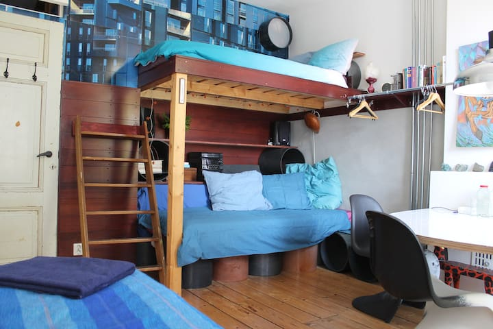 Blue bedroom in Superuse House