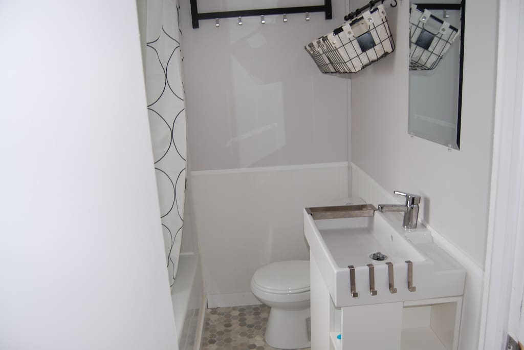 A bright bathroom with a tub is great feature for bathing little ones after a day at the beach.