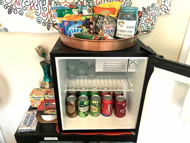 Large assortment of snacks/sodas available in room for a small fee of .50 for most snacks. Bottled waters are free