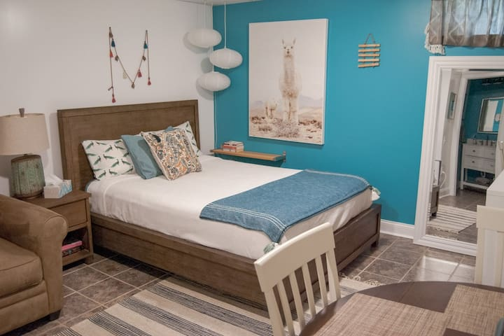 Studio room space with queen size bed and pull out twin bed.