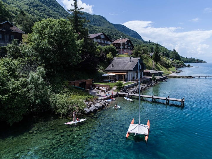 Waterfront villa with private beach - lake Geneva.